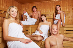 Men and women in mixed sauna. Smiling men and women sitting in a mixed sauna Royalty Free Stock Photos