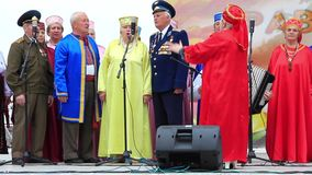 Men and women in multicoloured costume sing a song Royalty Free Stock Image