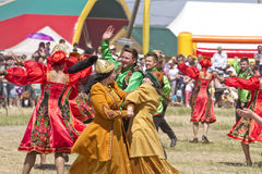 Men and women in national costumes dance traditional folk dances Stock Photo
