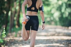 Fitness runner woman is stretching before jogging. royalty free stock images