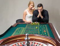 Men with women playing roulette at the casino. Stock Image