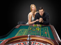 Men with women playing roulette at the casino. Stock Photo