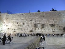 Men and women pray at the wailing wall early in the morning in Jerusalem stock images