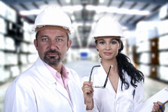 Men and women of quality control. Male and female quality control white helmet Stock Photography