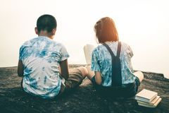 Men and women read books in quiet nature. stock image