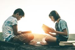 Men and women read books in quiet nature. stock images