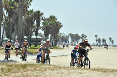Men and women riding on Tandems on Venice Beach stock photography