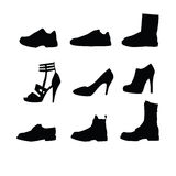 Men and women shoes silhouettes. Isolated on white background Royalty Free Stock Photography