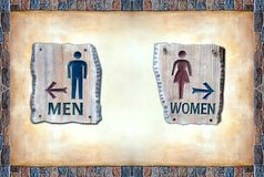 Men and Women Sign over color rock frame board Royalty Free Stock Photos
