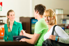 Men and women sign up at gym reception. Men and women sign up at reception for training Royalty Free Stock Photo