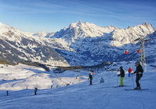 Men and women on ski  and snowboards near cable railway on winte Royalty Free Stock Photography
