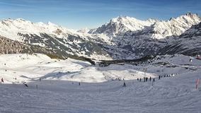 Men and women on ski  and snowboards at winter sport resort in s Stock Photos