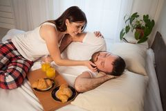 A man and a woman woke up in the morning, breakfast in bed stock photo