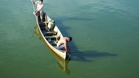 Men on wooden boat fishing at Taung Tha Man lake near U Bein bridge. Myammar stock footage