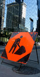 Men at work. Orange and black metal construction sign men at work Royalty Free Stock Photography