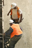 Men at work. Two men laying framework Royalty Free Stock Photo
