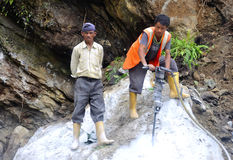 Men at work. Image of men drilling rocks for making smooth road at hills in sikkim, india. they are using hand drillers for cutting and drilling the rocks comes Stock Photography