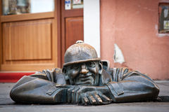 Men at Work. The famous Bratislava bronze statue, Men at Work, showing a man on the edge of a sewer opening stock images