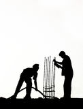 Men at work. Silhouette of men at work at some construction site Royalty Free Stock Images