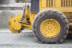Men at work, asphalt laying. Road-building. Road construction machinery. Road grader Royalty Free Stock Images