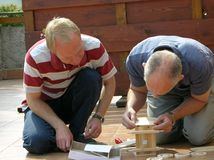 Men at work DIY Royalty Free Stock Photo
