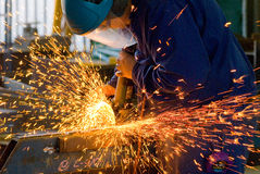 Men at work grinding steel Royalty Free Stock Photos