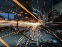Men at work grinding steel royalty free stock photography