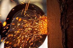 Men at work grinding steel Stock Photo