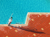 Men work and Pool Stock Images