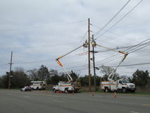 Men at work. PSEG workers replace power poles. royalty free stock photography