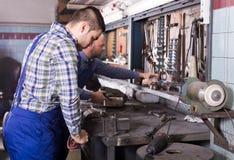 Men at work in repair shop Royalty Free Stock Photo