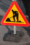 Men at work, road under construction sign Stock Photo