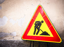 Men at work sign. At a road construction site in italy Royalty Free Stock Images