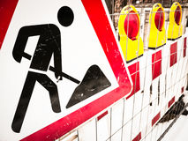 Men at work sign. At a road construction site in vienna Stock Photo