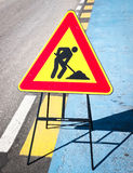 Men at work sign. At a street in italy Royalty Free Stock Photography