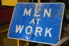 Men at Work Sign. A weathered Men at Work sign that could be used for a site that is under construction, etc Royalty Free Stock Photos