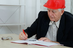 Men at work writing Royalty Free Stock Photos