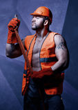 Men worker with orange helmet Royalty Free Stock Photography