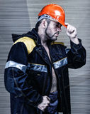 Men worker with orange helmet Royalty Free Stock Image