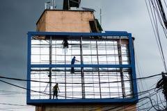 Men working on billboard Royalty Free Stock Image
