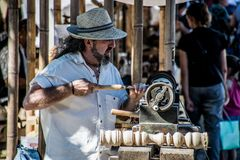 Carpenter working wood in an exhibition royalty free stock photo