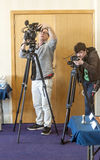 Men working with the cameras Royalty Free Stock Photography