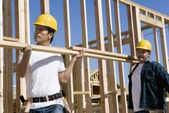 Men Working At A Construction Site Royalty Free Stock Image