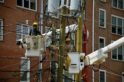 Men working on electricity poles Royalty Free Stock Photo