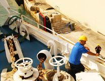 Men working on a ferry boat who cruising to Gozo Island Stock Photography