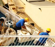Men working on a ferry boat who cruising to Gozo Island. GOZO ISLAND, MALTESE ISLANDS ,EUROPE - DECEMBER 5, 2014. Men working on a ferry boat who cruising to Royalty Free Stock Photography