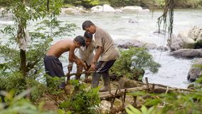 Men Working In Forest. Amazonian Deforestation, Building And Testing A Raft In Ecuador stock video