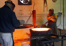 Men Working at the Foundry Hot Furnace Stock Images