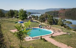 Men are working on the in-ground swimming pool. Workers built a swimming pool in resort in Pchelina Dam, Bulgaria Royalty Free Stock Photography