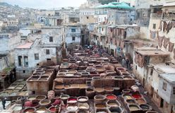 Men working hard in the tannery souk in Fez, Morocco Royalty Free Stock Images